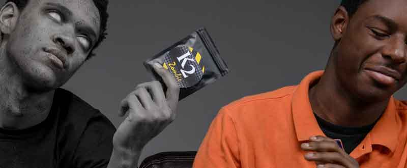 Healthy male teen rejecting K2 Zombie packet from zombie